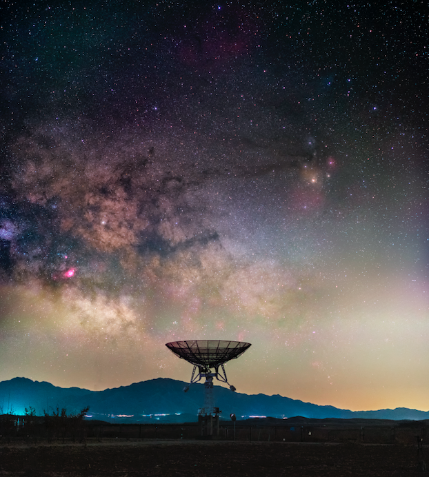 <p>The Milky Way rises ominously above a small radio telescope from a large array at Miyun Station, National Astronomical Observatory of China. (Pic: Haitong Yu) </p>