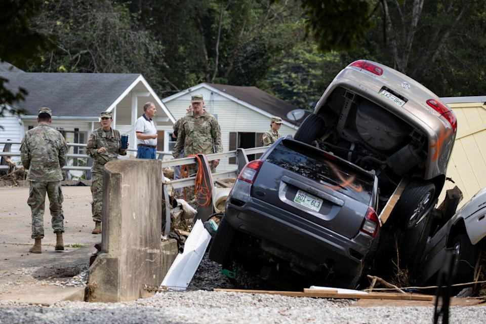 Members of the US Army survey flood damage on August 23, 2021 in Waverly, Tennessee.