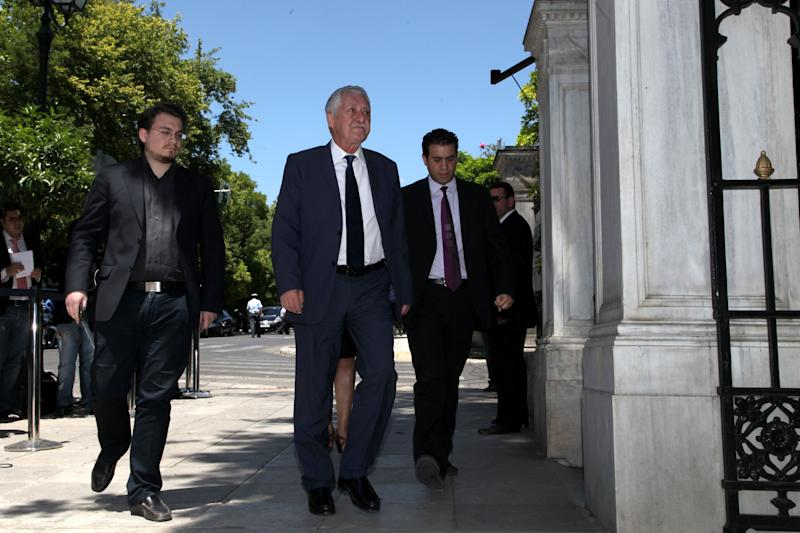 Greek leader of the Left Democratic party (DIMAR) Fotis Kouvelis, second left, arrives at the presidential palace for a meeting with President Karolos Papoulias in Athens, on Tuesday, May 15, 2012. Greece' president is to meet the leaders of five political parties, broadening talks to try and form a coalition government and end a nine-day deadlock in the crisis-hit country. (AP Photo/Petros Giannakouris)