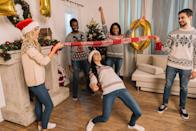 """<p>How low can you go? Use a Christmas scarf or candy cane prop to make this party game more festive, and for even more of a challenge, tuck a balloon in your shirts for """"Santa"""" bellies.</p><p><a class=""""link rapid-noclick-resp"""" href=""""https://www.amazon.com/Felice-Winter-Reindeer-Snowflake-Christmas/dp/B075M85W2Y/?tag=syn-yahoo-20&ascsubtag=%5Bartid%7C10050.g.22718533%5Bsrc%7Cyahoo-us"""" rel=""""nofollow noopener"""" target=""""_blank"""" data-ylk=""""slk:SHOP CHRISTMAS SCARVES"""">SHOP CHRISTMAS SCARVES</a></p>"""