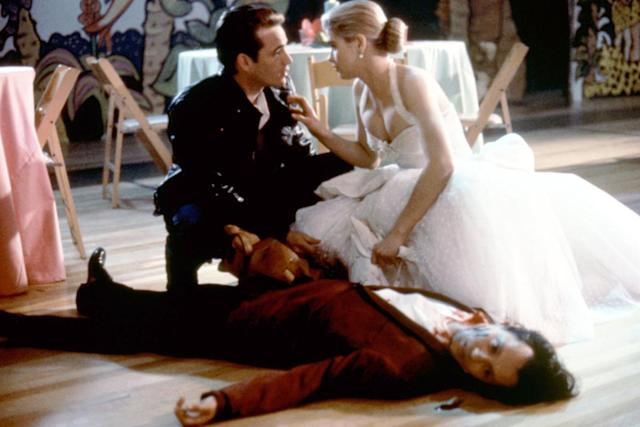 <p>Kristy Swanson slays her prom in an angelic white prom dress with a heart-shaped corset. After she kills the vampire who crashed, she kisses Luke Perry, takes his leather jacket, and leaves the prom to go slay the rest of the vampires. Enough said. (Photo: Everett Collection) </p>