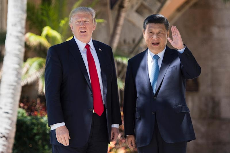 Chinese President Xi Jinping and US President Donald Trump agreed on the bilateral security dialogue at their April meeting in Florida (AFP Photo/JIM WATSON)