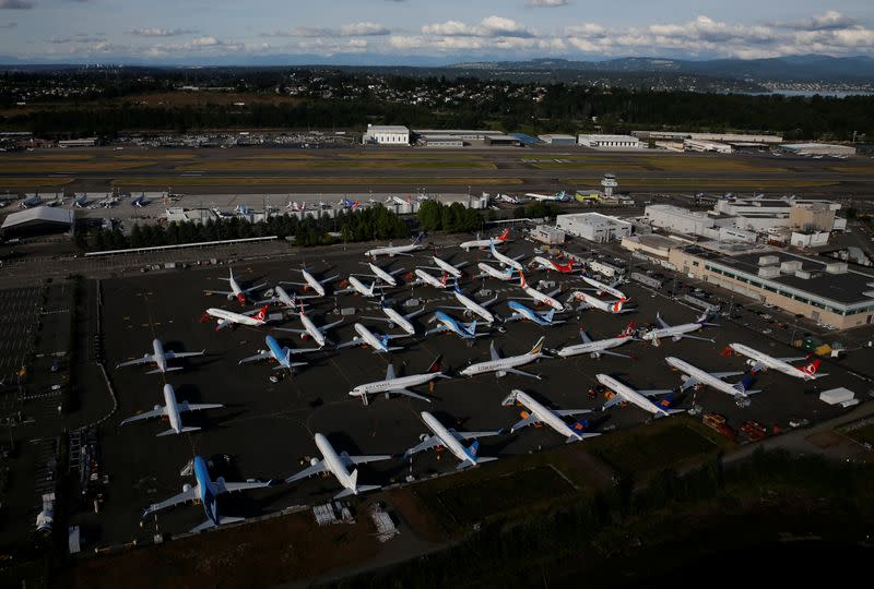 Boeing 737 Max aircraft are parked in a parking lot at Boeing Field in this aerial photo taken over Seattle
