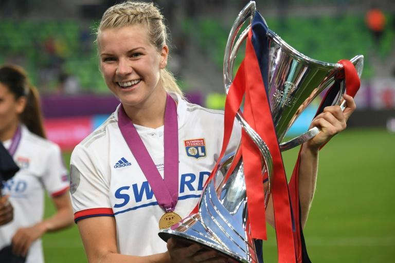 """Ada Hegerberg after winning last year's Champions League with Lyon. The Norwegian striker has signed a """"historic"""" seven-figure, 10-year deal with Nike (AFP Photo/Attila KISBENEDEK)"""