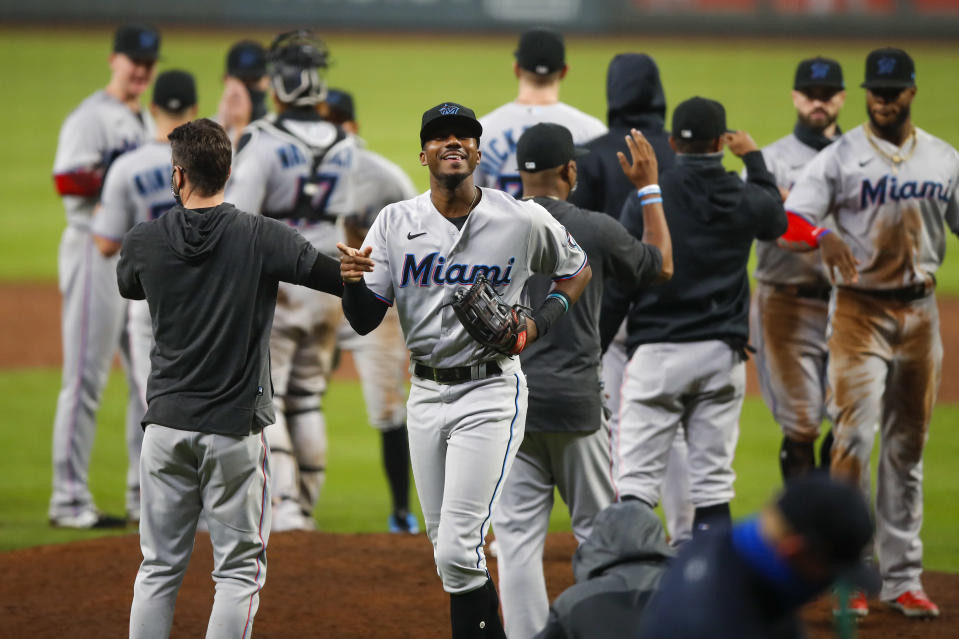 """ATLANTA, GA - SEPTEMBER 24: <a class=""""link rapid-noclick-resp"""" href=""""/mlb/players/10222/"""" data-ylk=""""slk:Lewis Brinson"""">Lewis Brinson</a> #25 of the Miami Marlins reacts at the conclusion of an MLB game against the Atlanta Braves at Truist Park on September 24, 2020 in Atlanta, Georgia. (Photo by Todd Kirkland/Getty Images)"""
