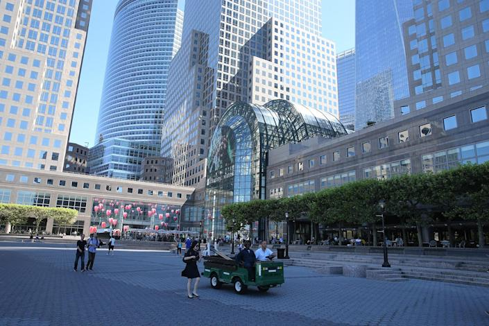 <p>Pedestrians walk through the courtyard just outside of Brookfield Place (originally known as the World Financial Center) in lower Manhattan on Aug. 23, 2016. (Gordon Donovan/Yahoo News) </p>