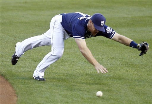 San Diego Padres second baseman Logan Forsythe makes an unsuccessful diving attempt for a base hit by Seattle Mariners' Michael Saunders during the second inning of a baseball game Saturday, June 23, 2012, in San Diego. (AP Photo/Lenny Ignelzi)