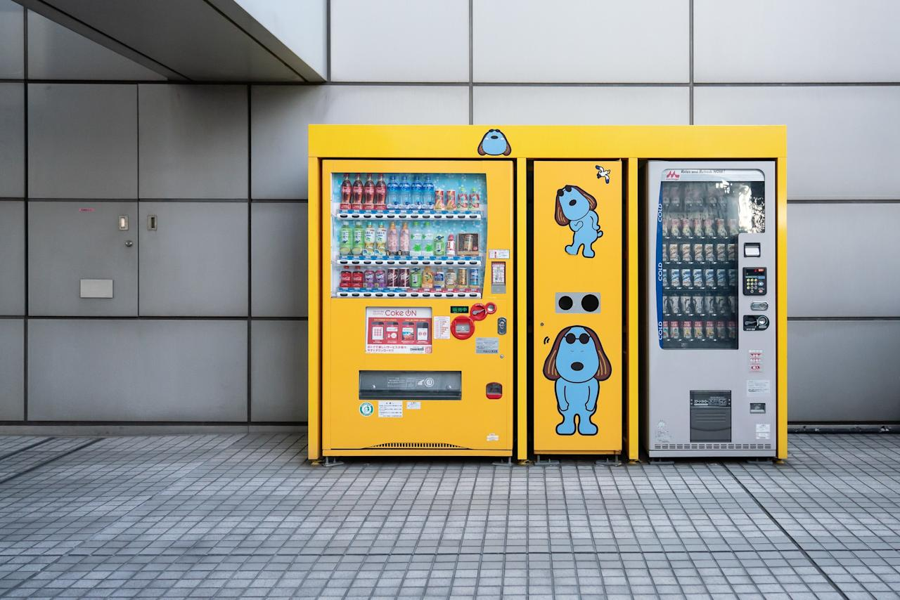 """One of Easley's favorites is a bright yellow vending machine featuring Laugh the Dog, which is located halfway up the imposing entrance staircase to the Fuji TV Headquarters in Odaiba, Tokyo. """"It's such a gigantic gray concrete building,"""" he says. """"And finding that machine tucked away to the side of one of the long escalators used to enter the building was such a massive juxtaposition but also felt like a completely natural thing in Japan, where corporate mascots and vending machines are quite normal."""""""