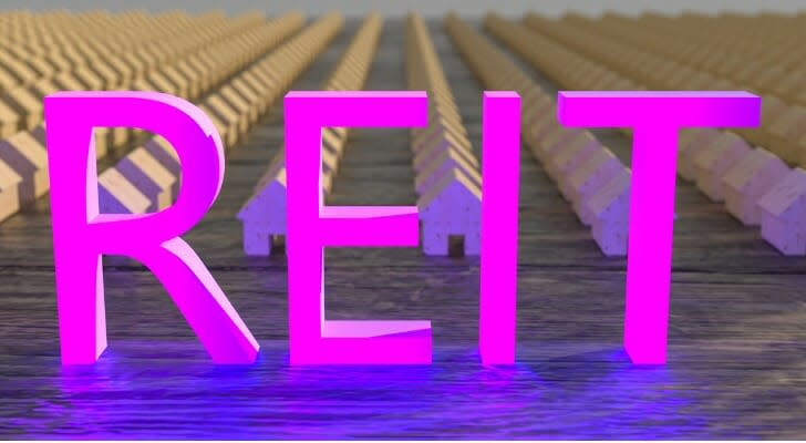 REIT in pink letters