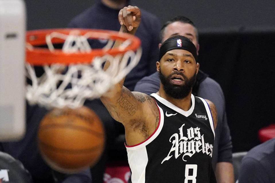 Los Angeles Clippers forward Marcus Morris Sr. watches his shot go through during the first half of an NBA basketball game against the Philadelphia 76ers Saturday, March 27, 2021, in Los Angeles. (AP Photo/Mark J. Terrill)