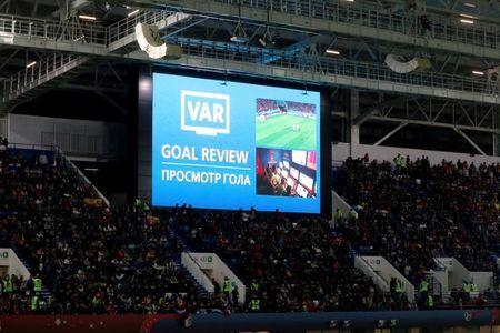 Soccer Football - World Cup - Group B - Spain vs Morocco - Kaliningrad Stadium, Kaliningrad, Russia - June 25, 2018 General view of the scoreboard during a VAR review after Spain's Iago Aspas scored their second goal which was initially ruled offside REUTERS/Mariana Bazo