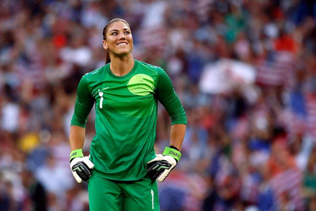 LONDON, ENGLAND - AUGUST 09: Goalkeeper Hope Solo #1 of United States reacts after Carli Lloyd #10 of United States scores a goal in the first half against Japan during the Women's Football gold medal match on Day 13 of the London 2012 Olympic Games at Wembley Stadium on August 9, 2012 in London, England. (Photo by Jamie Squire/Getty Images)