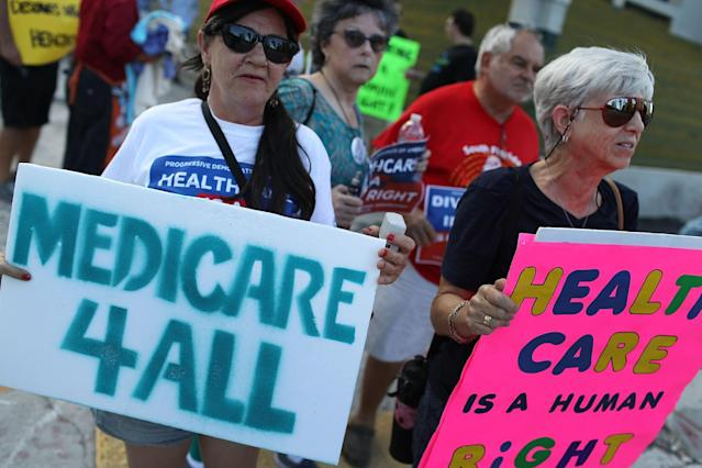 <p>P.J. Espinal (L) and Ronne Denbo join with other protesters against Republican senators who have not spoken up against Affordable Care Act repeal and demand universal, affordable, quality healthcare for all on July 24, 2017 in Fort Lauderdale, Fla. (Photo: Joe Raedle/Getty Images) </p>