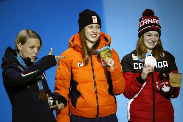 Medals Ceremony - Short Track Speed Skating Events - Pyeongchang 2018 Winter Olympics - Women's 1000m - Medals Plaza - Pyeongchang, South Korea - February 23, 2018 - Gold medalist Suzanne Schulting of the Netherlands, silver medalist Kim Boutin of Canada and bronze medalist Arianna Fontana of Italy on the podium. REUTERS/Kim Hong-Ji