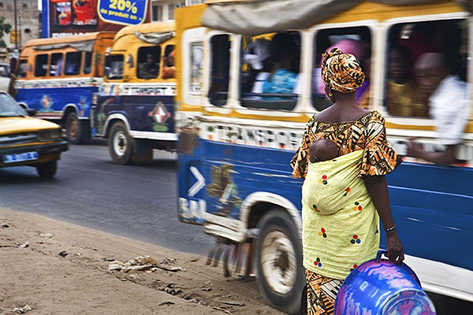 Dakar, Senegal. <br><br>Woman and child wait to cross busy street. <br><br>Camera: Canon 40D Edgard de Bono, Italy <br><br>Winner, New Talent portfolio. Diary of a Destination
