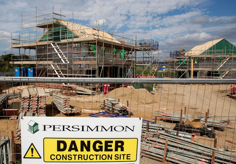 A warning sign is displayed at a Persimmon construction site in Dartford, Britain August 21, 2015. REUTERS/Neil Hall/File Photo
