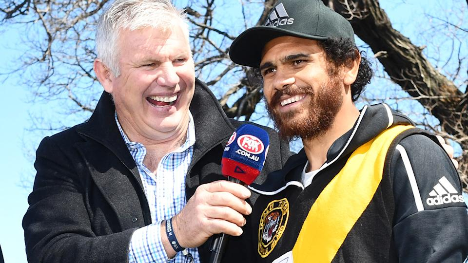 Danny Frawley and Cyril Rioli, pictured here on AFL Grand Final Day in 2018.