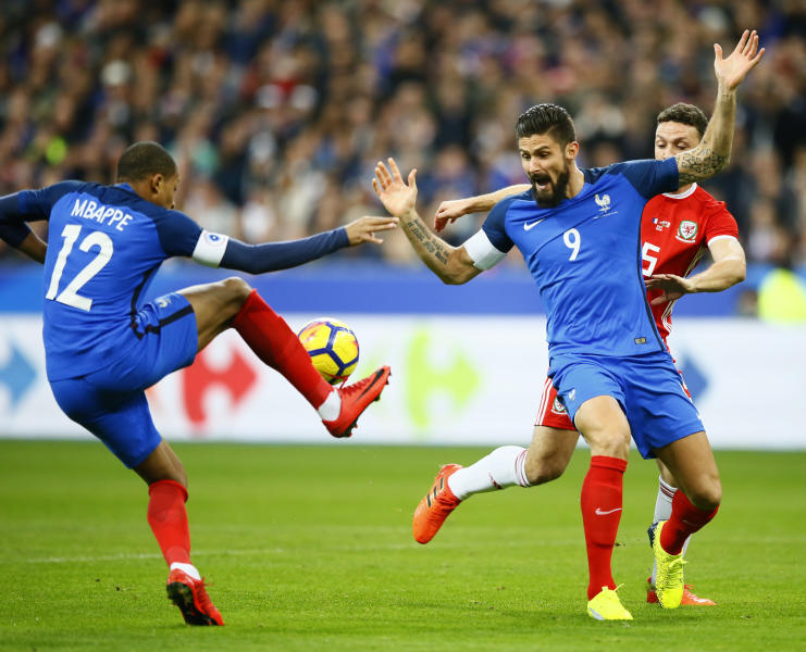 France's Kylian Mbappe, left, controls the ball while his teammate Olivier Giroud reacts during an international friendly soccer match between France and Wales at Stade de France in Saint Denis, a northern suburb of Paris, France, Friday, Nov. 10, 2017. (AP Photo/Francois Mori)