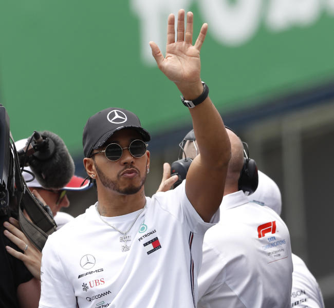 Mercedes driver Lewis Hamilton, of Britain, waves to the crowd during the opening parade of the Brazilian Formula One Grand Prix at the Interlagos race track in Sao Paulo, Brazil, Sunday, Nov. 17, 2019. (AP Photo/Nelson Antoine)