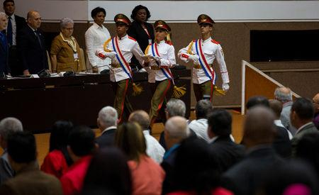 Honour guards carry the new constitution at the National Assembly, in Havana, Cuba April 10, 2019.  Irene Perez/Courtesy Cubadebate/Handout via REUTERS