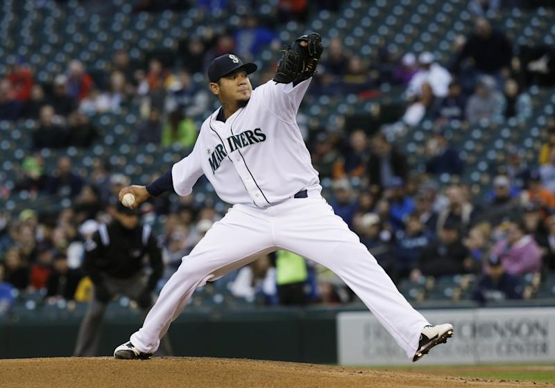 Seattle Mariners starting pitcher Felix Hernandez throws in the first inning of a baseball game against the Detroit Tigers, Wednesday, April 17, 2013, in Seattle. (AP Photo/Ted S. Warren)
