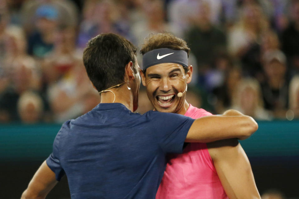 MELBOURNE, AUSTRALIA - JANUARY 15: Novak Djokovic of Serbia and Rafael Nadal of Spain hug during the Rally for Relief Bushfire Appeal event at Rod Laver Arena on January 15, 2020 in Melbourne, Australia. (Photo by Darrian Traynor/Getty Images)