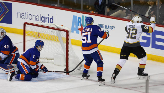 Vegas Golden Knights left wing Tomas Nosek (92) celebrates after scoring a goal against New York Islanders goaltender Robin Lehner, defenseman Thomas Hickey (4) and center Valtteri Filppula (51) during the third period of an NHL hockey game, Wednesday, Dec. 12, 2018, in New York (AP Photo/Noah K. Murray)