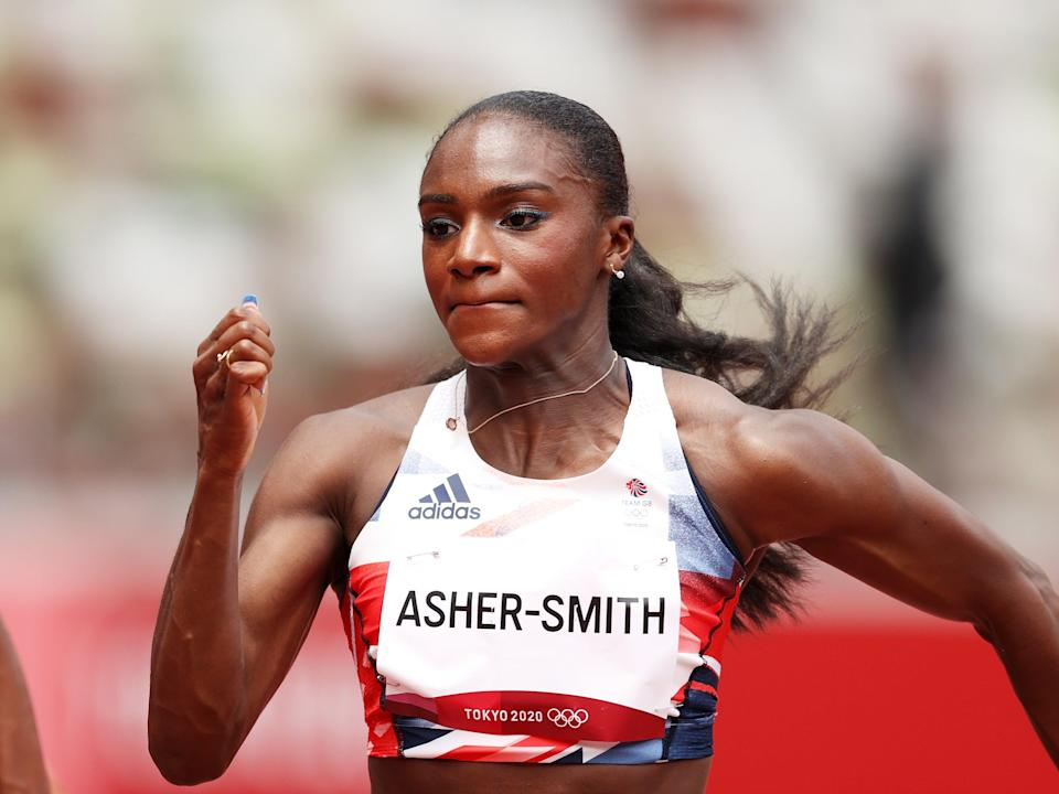 Dina Asher-Smith of Team Great Britain competes in round one of the Women's 100m (Getty)