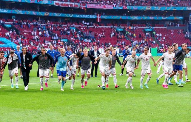 Denmark players celebrate victory after the final whistle at Euro 2020 against Wales in Amsterdam