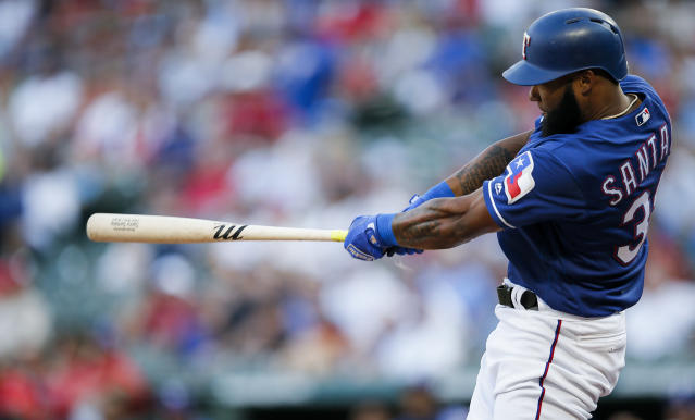 Texas Rangers' Danny Santana makes contact for a solo home run during the second inning of a baseball game against the Houston Astros, Friday, July 12, 2019, in Arlington, Texas. (AP Photo/Brandon Wade)