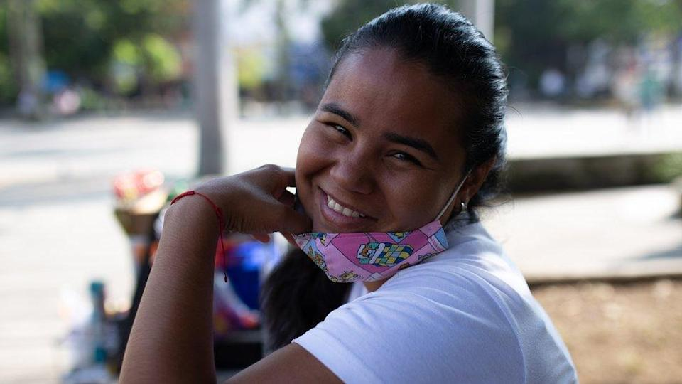 Danexi Andrade smiles while she is selling sweets in Medellin