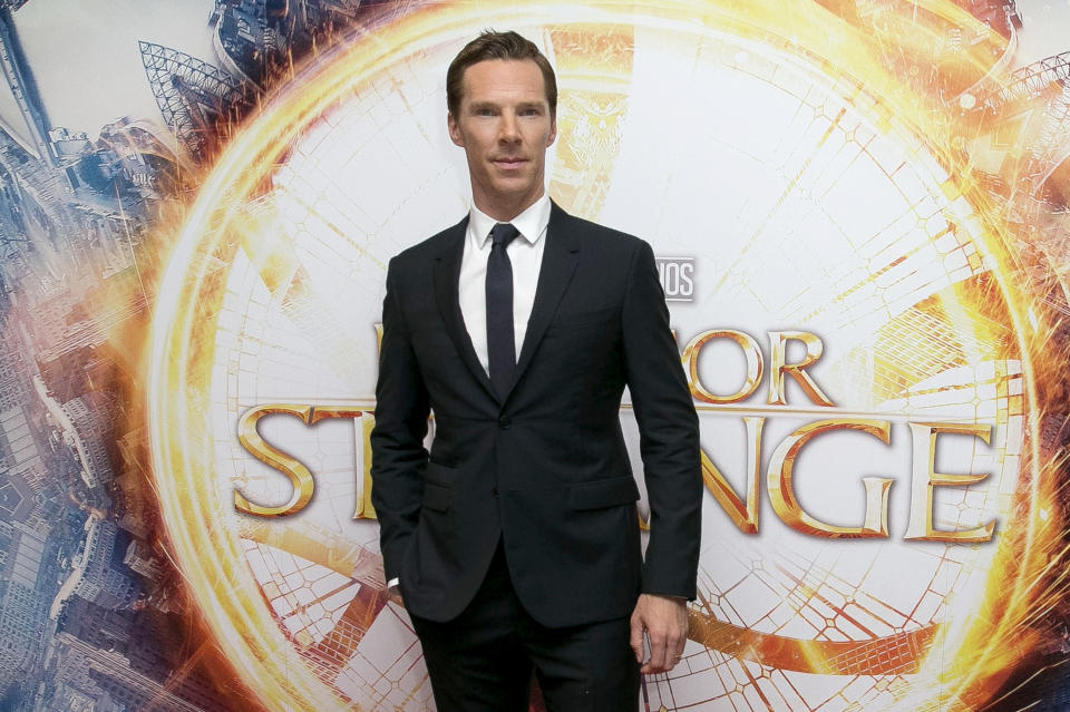"""FILE - In this Oct. 24, 2016 file photo, Benedict Cumberbatch poses for photographers upon arrival at the launch event of the film """"Doctor Strange"""" in London. Hollywood studios are shuffling more release dates as a result of the coronavirus, including """"Doctor Strange 2"""" and the sequels to """"Spider-Man: Far From Home"""" and """"Into the Spider-Verse."""" Late Friday, both Sony Pictures and The Walt Disney Co. announced updated theatrical release schedules including some significant delays to some of their marquee superhero films. """"Doctor Strange in the Multiverse of Madness"""" will now open in 2022. (Photo by Joel Ryan/Invision/AP, File)"""