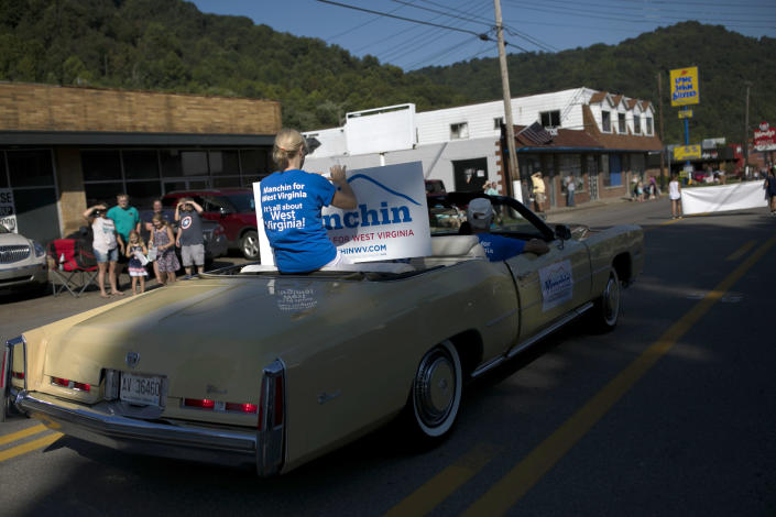 A Cadillac with signs supporting Sen. Joe Manchin (D-W.V.) leads the Labor Day parade in Marmet, W.V., Sept. 3, 2018. (Maddie McGarvey/The New York Times)