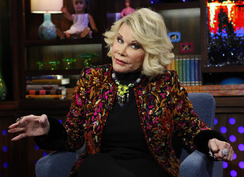 "FILE -  This Feb. 16, 2012 file photograph originally released by Bravo shows Joan Rivers appearng on Bravo's ""Watch What Happens Live"" show on  in New York. Police were called to a Costco store in a Los Angeles suburb after comedian Joan Rivers handcuffed herself to a shopping cart to protest the store, which is not selling her latest book. The 79-year-old ""Fashion Police"" host was being filmed by a camera crew Tuesday, Aug. 7, as she complained that the store in Burbank, Calif., had refused to carry her book, ""I Hate Everything... Starting With Me."" Burbank city spokesman Drew Sugars says the store manager called police, who sent officers to the scene because they were uncertain of the scale of the situation. They ended up escorting Rivers from the store, and she and her crew left without incident. Sugars says there were no citations or arrests. (AP Photo/Bravo, Peter Kramer, file)"