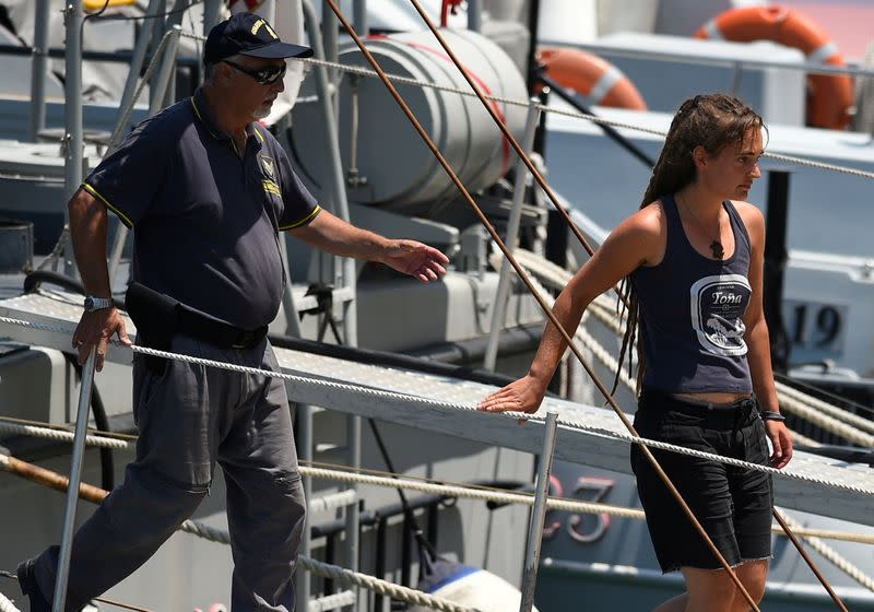 FILE PHOTO: Carola Rackete, the 31-year-old Sea-Watch 3 captain, disembarks from a Finance police boat, in Porto Empedocle