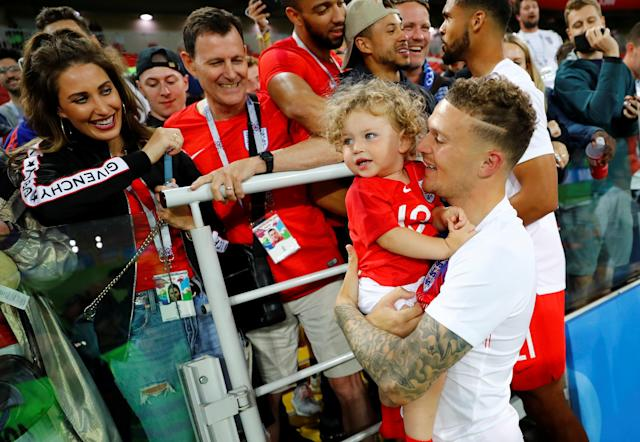 <p>England's Kieran Trippier with a child after the match. REUTERS/Kai Pfaffenbach </p>