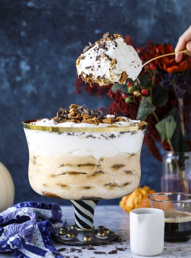"""<p>Mix all the warm, cozy flavors of maple, pumpkin, and ginger together into this coffee-infused trifle.</p><p><strong>Get the recipe at <a href=""""https://www.howsweeteats.com/2017/11/pumpkin-tiramisu-maple-gingersnap-trifle/"""" rel=""""nofollow noopener"""" target=""""_blank"""" data-ylk=""""slk:How Sweet Eats"""" class=""""link rapid-noclick-resp"""">How Sweet Eats</a>. </strong></p><p><strong><strong><strong><a class=""""link rapid-noclick-resp"""" href=""""https://www.amazon.com/Anchor-Hocking-Monaco-Trifle-Bowl/dp/B0002YSLXC/?tag=syn-yahoo-20&ascsubtag=%5Bartid%7C10050.g.2721%5Bsrc%7Cyahoo-us"""" rel=""""nofollow noopener"""" target=""""_blank"""" data-ylk=""""slk:SHOP TRIFLE BOWLS"""">SHOP TRIFLE BOWLS</a></strong></strong><br></strong></p>"""