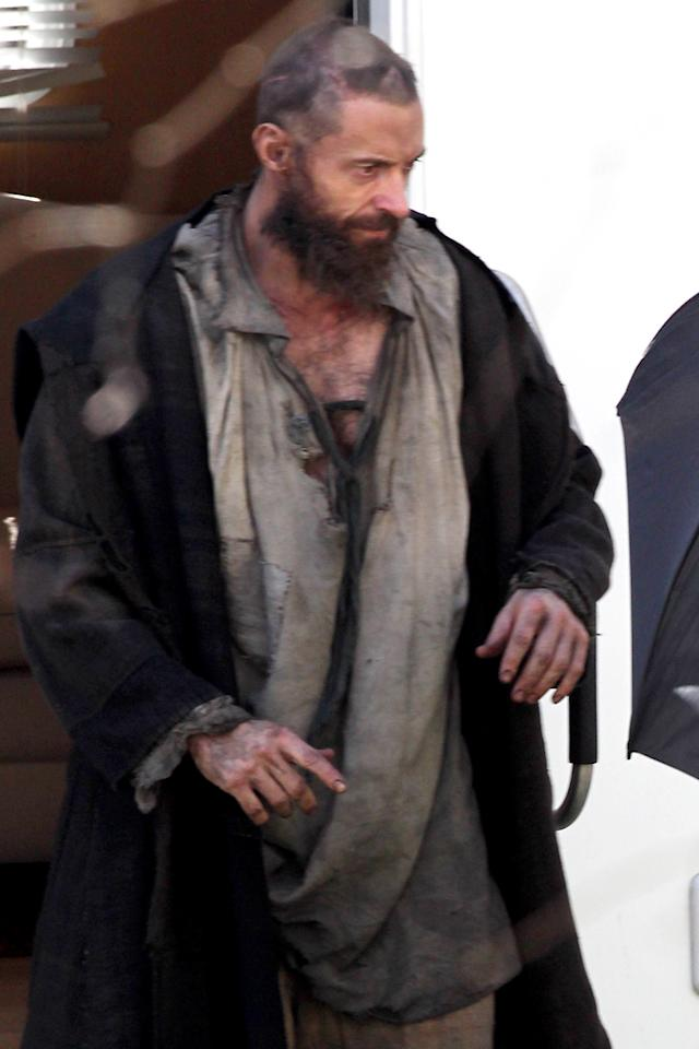 Hugh Jackman as prisoner Jean Valjean in 'Les Miserables.' Great lengths were taken to shield his bedraggled appearance, including a livid scar on the side of his head in London, UK.<br>(photo by SplashNews)