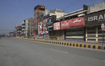 A market is deserted due to the closure after the government announced new restrictions for the COVID-19 measures, in Peshawar, Pakistan, Saturday, May 8, 2021. Pakistani authorities started implementing a plan of nine-days lockdown from May 8 to 16 till end of the Eid al-Fitr holidays. New restrictions also include closure of all tourist resorts, beaches, hotels, restaurants, shopping centers, parks and other public places to try to control the spread of the coronavirus. (AP Photo/Muhammad Sajjad)