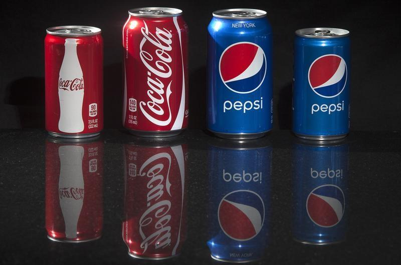 Regular and mini cans of Coke and Pepsi are pictured in this photo illustration in New York