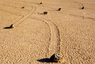 <b>The sliding stones of Death Valley, California</b> - The movement of the rocks continue to baffle experts, with some rocks sliding across a perfectly flat bed despite weighing up to 700 pounds each. (Alexandra Sailer/Ardea/Caters News)