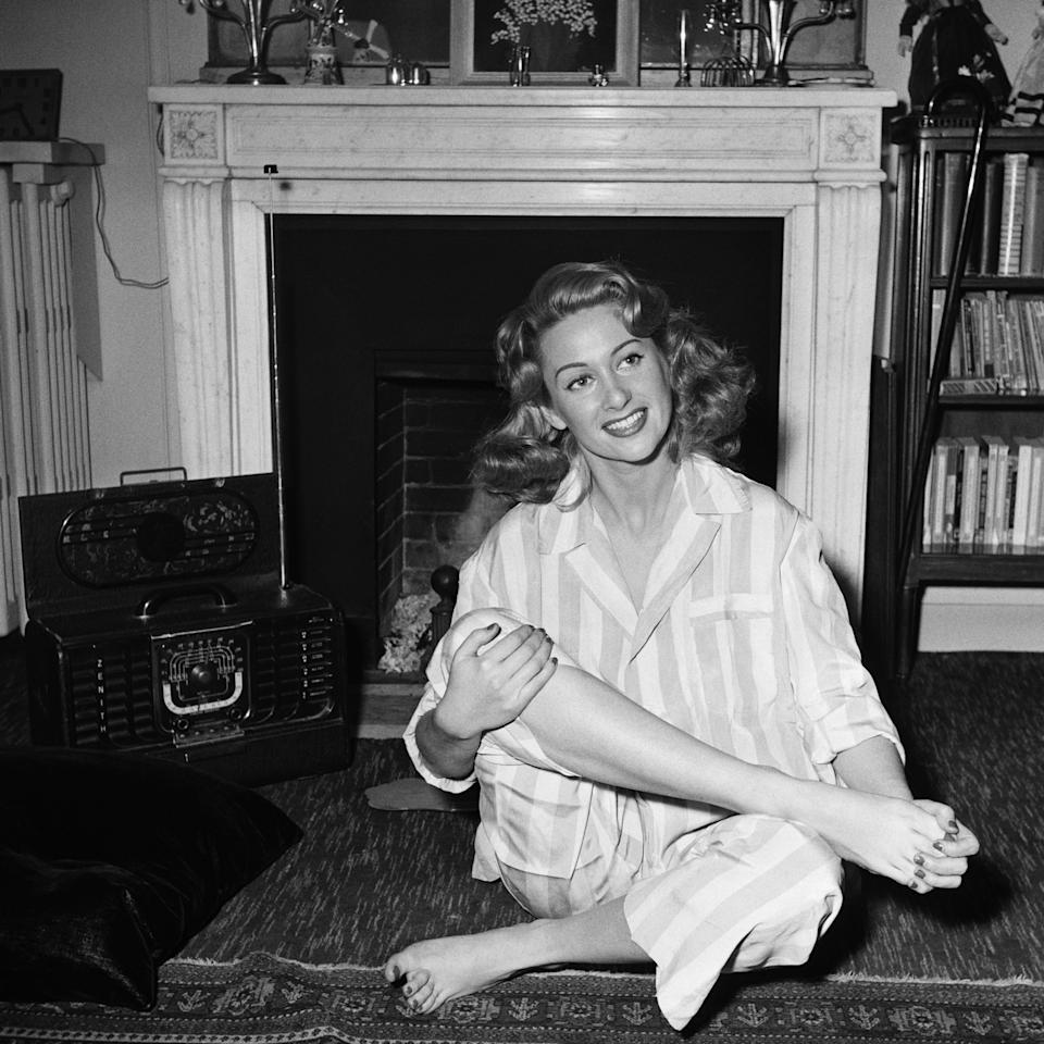 French actress Martine Carol at home in pajamas, undated.