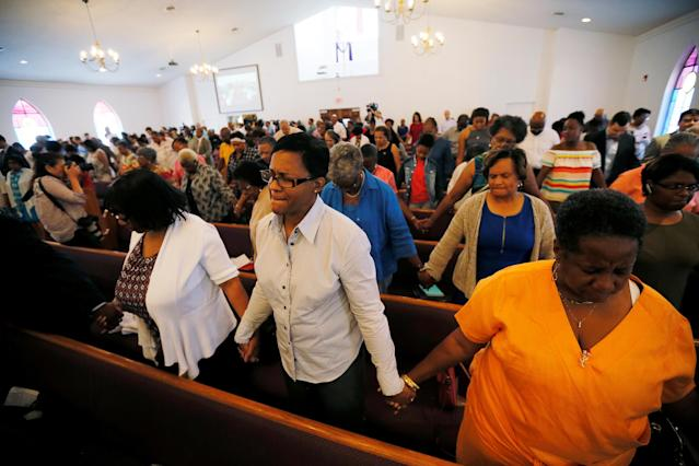 """<p>Members of Charlottesville's Mt. Zion First African Baptist Church pray during Sunday services the morning after the attack on counter-protesters at the """"Unite the Right"""" rally organized by white nationalists in Charlottesville, Virginia, U.S., August 13, 2017. (Jim Bourg/Reuters) </p>"""