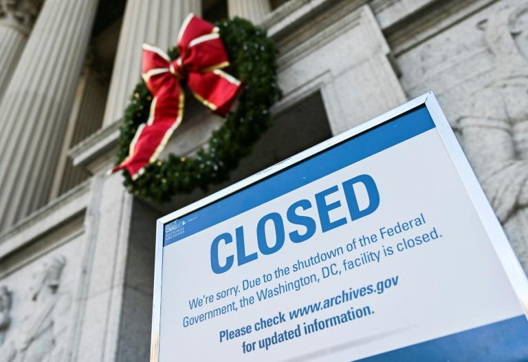 "Washington's National Archives building -- home to the US Declaration of Independence, the Constitution and other historic documents, displays a ""closed"" sign because of the partial US government shutdown"