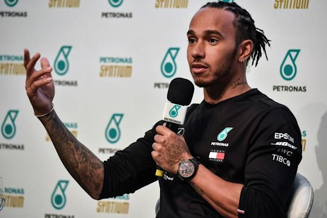 Lewis Hamilton says Formula One's leading drivers could be with new teams next season (AFP Photo/NELSON ALMEIDA)