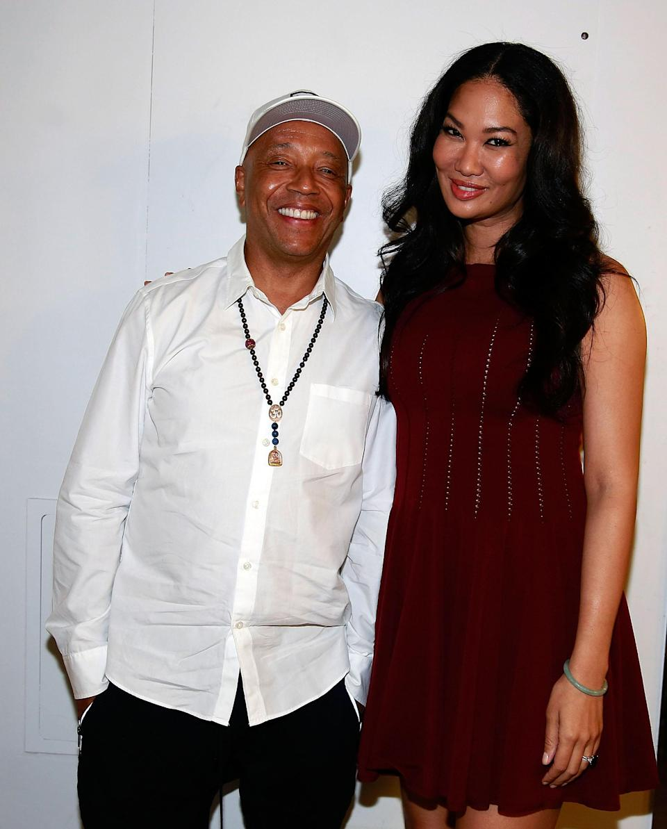 Kimora Lee Simmons supports Russell Simmons at a fashion show in 2014. (Photo: Shareif Ziyadat/FilmMagic)
