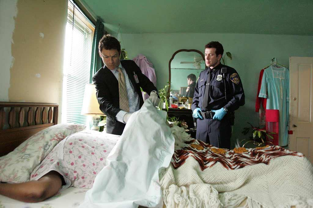 McNulty takes in the crime scene with Officer Bobby Brown (Dominic West) in The Wire.