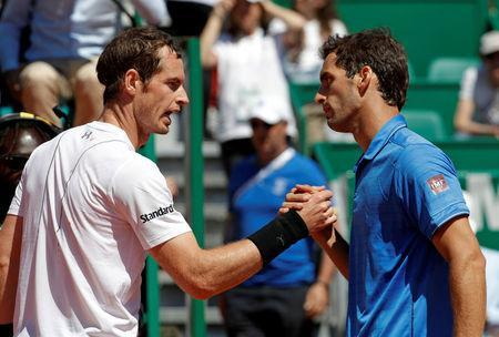 Tennis - Monte Carlo Masters - Monaco, 20/04/2017. Albert Ramos-Vinolas of Spain (R) shakes hands with Andy Murray of Britain after winning their match. REUTERS/Eric Gaillard