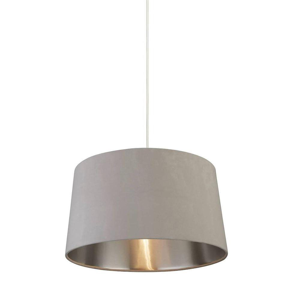 """<p>This House Beautiful shade ticks two trend boxes, with its classic mink grey colour and tactile velvet material. With a brushed metallic inner to disperse a soft light, this would make a great choice for a neutral bedroom. </p><p><strong>Shop now: <a href=""""https://www.homebase.co.uk/samet-velvet-drum-shade-grey-45cm/12882892.html"""" rel=""""nofollow noopener"""" target=""""_blank"""" data-ylk=""""slk:House Beautiful Samet Velvet Lampshade at Homebase"""" class=""""link rapid-noclick-resp"""">House Beautiful Samet Velvet Lampshade at Homebase</a></strong></p>"""