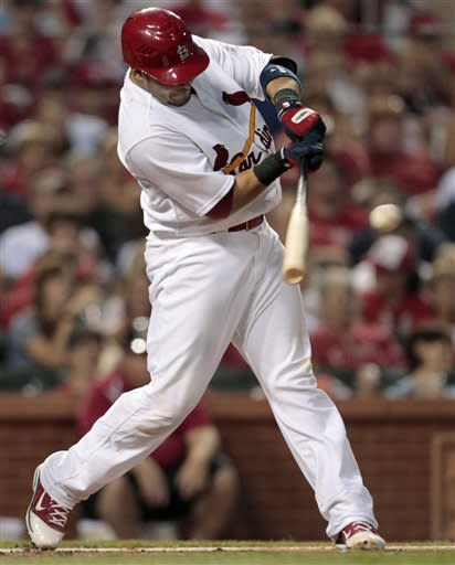 St. Louis Cardinals' Yadier Molina hits an RBI single during the fourth inning of a baseball game against the Philadelphia Phillies on Friday, May 25, 2012, in St. Louis. (AP Photo/Jeff Roberson)